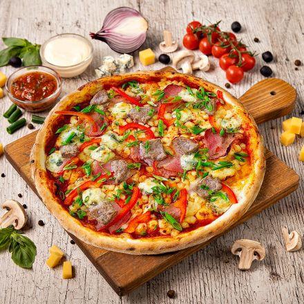 Пицца с сыром дорблю